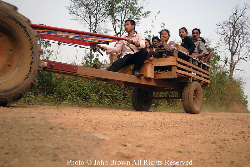 Subsistence farmers ride in a tractor towards Ban Buamlao, near Ban Latchock, a few kilometers from Pak Leung, Laos.