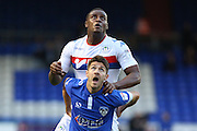 Ryan Flynn of Oldham Athletic and Donervon Daniels of Wigan Athletic tussle for the ball during the EFL Cup match between Oldham Athletic and Wigan Athletic at Boundary Park, Oldham, England on 9 August 2016. Photo by Simon Brady.