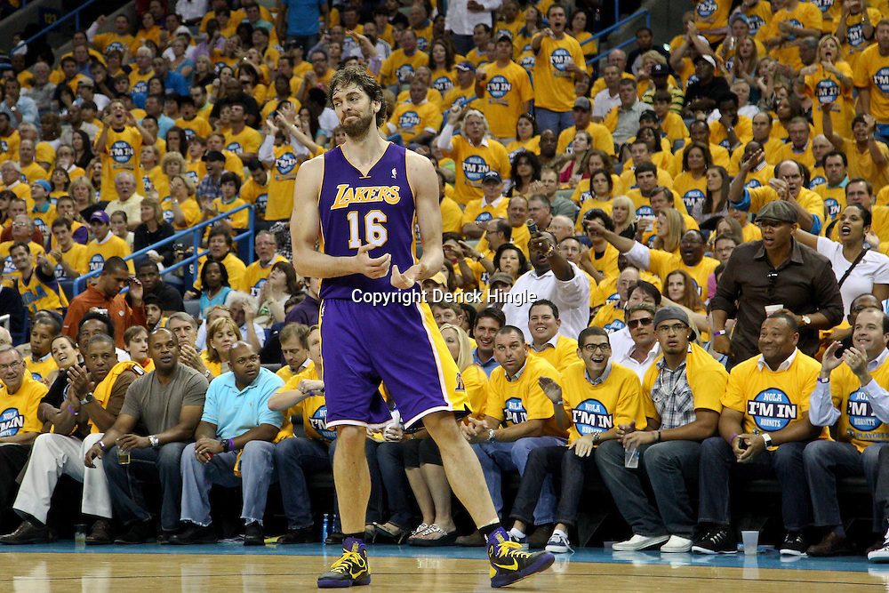April 22, 2011; New Orleans, LA, USA; Los Angeles Lakers power forward Pau Gasol (16) reacts after being called for a foul during the second half in game three of the first round of the 2011 NBA playoffs against the New Orleans Hornets at the New Orleans Arena. The Lakers defeated the Hornets 100-86.   Mandatory Credit: Derick E. Hingle