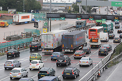 © Licensed to London News Pictures. 25/08/2014. Dartford.  The lorry in a lay-by at Dartford Crossing (left). 13 suspected illegal immigrants have been found in the back of a lorry at Darford River Crosing this morning (25.08.2014) about 11.30 am. One person has been taken to hospital while the immigration service investigate.<br />
