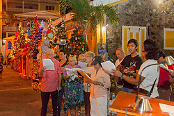 St. Anne's Choir sing Christmas selctions for the crowd.  Frenchtown Civic Organization/French Heritage Museum presents its 3rd Annual Festival of Lights Christmas Tree Competition in Frenchtown.  St. Thomas, USVI.  11 December 2016.  © Aisha-Zakiya Boyd