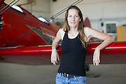 Wing walker Carol Pilon poses for a portrait at the Dunkirk Airport in Dunkirk, New York on Saturday, July 2, 2016.