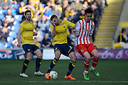 Oxford midfielder Liam Sercombe and Stevenage striker Greg Luer battle for the ball during the Sky Bet League 2 match between Oxford United and Stevenage at the Kassam Stadium, Oxford, England on 25 March 2016. Photo by Alan Franklin.