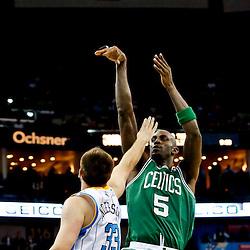 Mar 20, 2013; New Orleans, LA, USA; Boston Celtics center Kevin Garnett (5) shoots over New Orleans Hornets power forward Ryan Anderson (33) during the second half of a game at the New Orleans Arena. The Hornets defeated the Celtics 87-86. Mandatory Credit: Derick E. Hingle-USA TODAY Sports