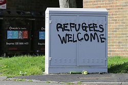 """© Licensed to London News Pictures. 03/04/2017. Croydon, UK. Graffiti reading """"REFUGEES WELCOME"""" near the scene of a racial attack on a teenage asylum seeker by a gang of youths. Ten people have arrested, five charged and three remain in custody in relation with the incident which took place late on Friday evening.  Photo credit: Presspics/LNP"""