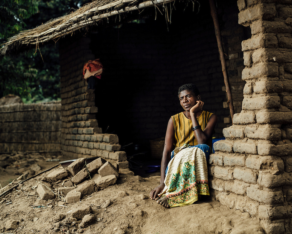 "Patuma Uladi, 38, Mkweta Village, Malawi. ""I lost my home."" 