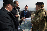 Image shows soldiers from the Military Stabilisation &amp; Support group inspecting maps of the Zenica area - heavily flooded by by the River Bosna in 2014.<br /> <br /> 16/03.2014<br /> <br /> Credit should read: Cpl Mark Larner, Media Ops Group.<br /> <br /> Exercise Civil Bridge is an exercise in support of UK Defence Engagement by elements of 77 Brigade. Civil Bridge 14B (CB14B) is being conducted Sarajevo, Bosnia &amp; Herzegovina (BiH).<br /> <br /> By assisting the BiH Government to develop their contingency plans for natural disasters at both strategic and operational levels, CB14B will contribute to the long term international effort to stabilise BiH ethnic groups and authorities.