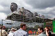 "A man filming on top of Stalin's replica head, in front members of the TV crew. For a TV movie called ""Monstrum"" produced by the Czech Television a huge replica of Soviet dictator Joseph Stalin was installed at metronome in the Czech capital. From May 1, 1955, until it was destroyed at the end of 1962  a giant granite statue of Stalin with a line of workers and scientists behind him was standing exactly at the same place."