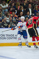 PENTICTON, CANADA - SEPTEMBER 17: Stepan Falkovsky #80 of Calgary Flames checks Tomas Soustal #41 of Edmonton Oilers on September 17, 2016 at the South Okanagan Event Centre in Penticton, British Columbia, Canada.  (Photo by Marissa Baecker/Shoot the Breeze)  *** Local Caption *** Tomas Soustal; Stepan Falkovsky;