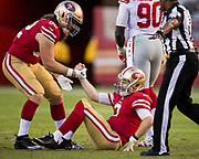 San Francisco 49ers tight end Logan Paulsen (82) helps San Francisco 49ers quarterback C.J. Beathard (3) up after being sacked by the New York Giants at Levi's Stadium in Santa Clara, Calif., on November 12, 2017. (Stan Olszewski/Special to S.F. Examiner)