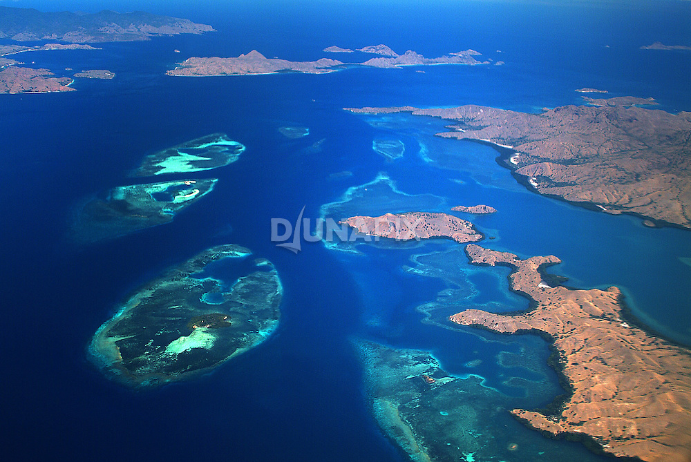 Aerial view of Komodo National Park. Komodo, Rinca and Padar islands are visible from lower right to upper left.