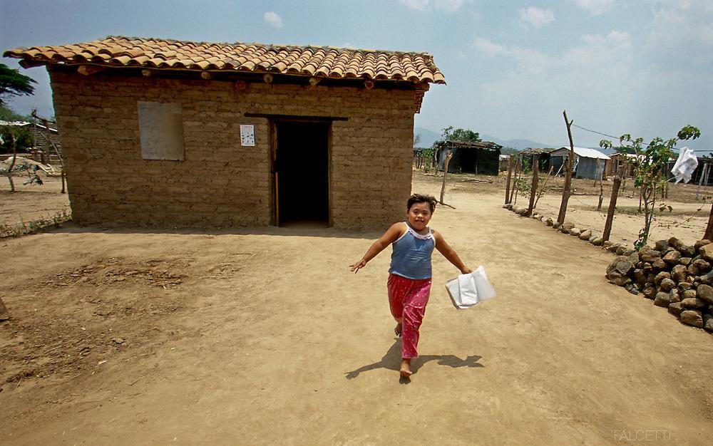 SANTA FE, EL SALVADOR- MAY 2000:  A child runs home from school in the small aldea of Santa Fe, El Salvador. According to UNICEF, only 69% of primary school entrants reach grade 5.  (Photo by Robert Falcetti). .