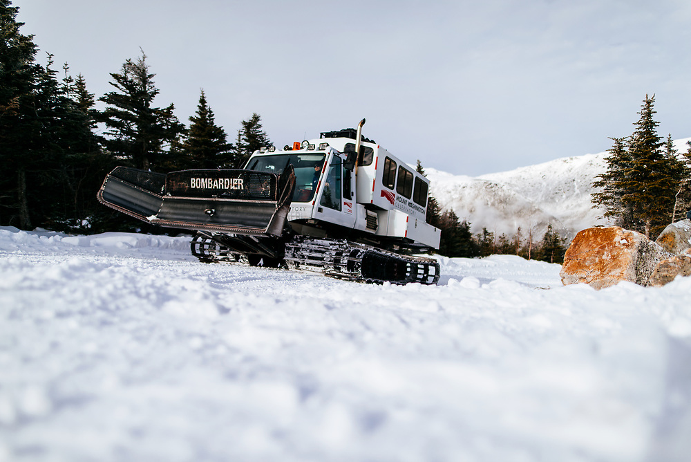 Mount Washington Observatory's Snowcat ascending the auto road in winter with a guided group.
