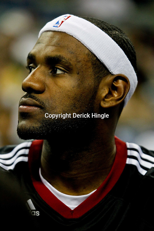 October 13, 2010; New Orleans, LA, USA; Miami Heat small forward LeBron James (6) watches from the bench during the second half of a preseason game against the New Orleans Hornets at the New Orleans Arena. The Hornets defeated the Heat 90-76. Mandatory Credit: Derick E. Hingle