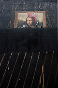 Mona Lisa street mural peeks from upper layer of paint on hoarding of central London street. Mr. Brainwash is the moniker of Los Angeles-based filmmaker and Pop artist Thierry Guetta.