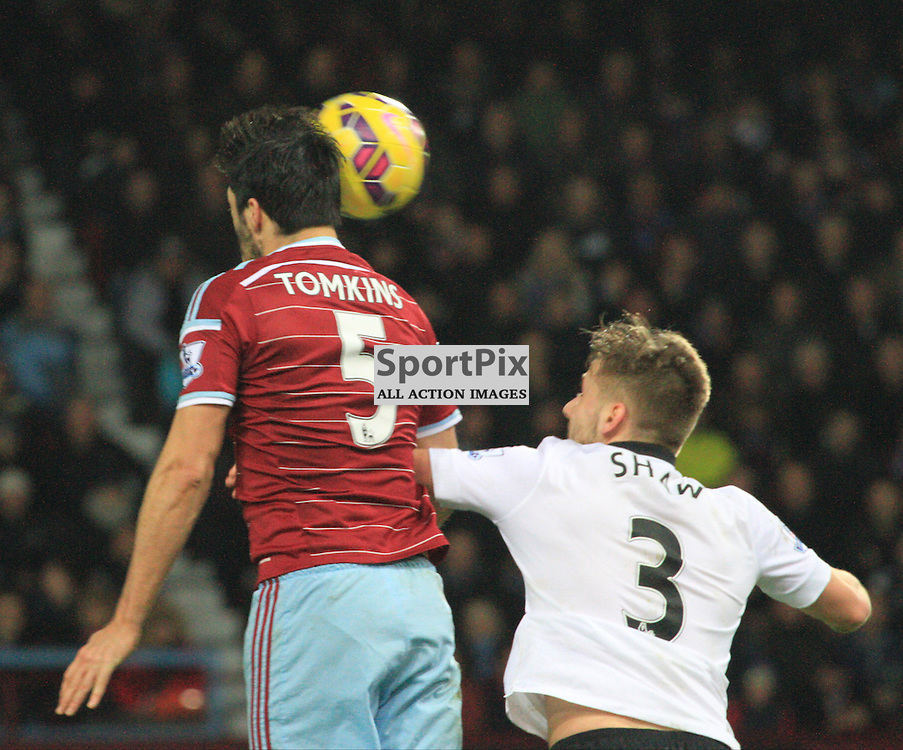 James Tomkins battles with Luke Shaw of Manchester United During the game between West Ham United and Manchester United on Sunday 8th February 2016