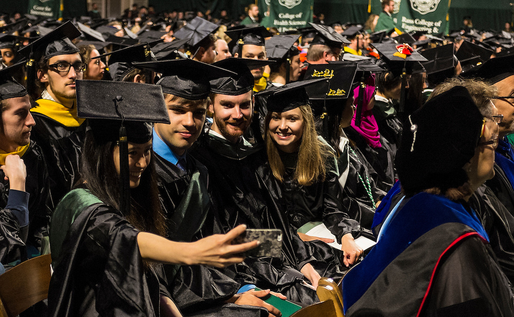 A group of master's students from the College of Arts and Sciences gather for a selfie during Ohio University's graduate commencement on Friday, May 1, 2015.  Photo by Ohio University  /  Rob Hardin