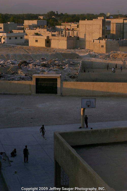 Iraqi bosy play soccer in the Iraqi area of Damascus, Syria, Monday, July 14, 2003. Hundreds of thousands of Iraqi Shiite settled in Syria after the Gulf War and their uprising against Saddam Hussein in 1991.