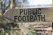 Arrow direction pointer on wooden public footpath sign, Sutton, Suffolk, England