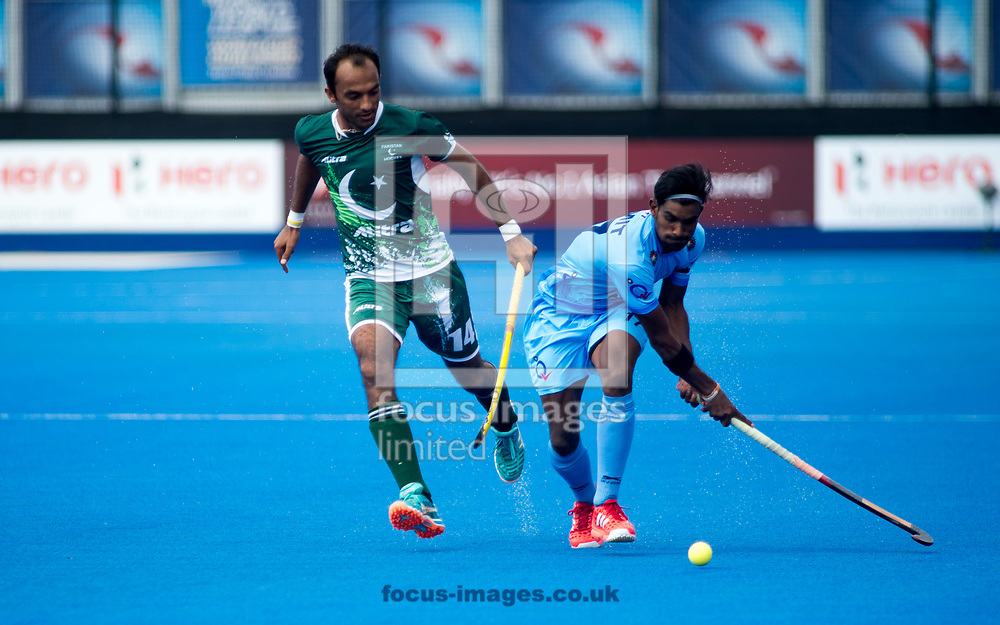 Muhammad Umar Bhutta of Pakistan and Vikas Dahiya of India battle for the ball on day four of the Men's Hero Hockey World League Semi-Finals at Lee Valley Hockey Centre, Stratford<br /> Picture by Hannah Fountain/Focus Images Ltd 07814482222<br /> 18/06/2017
