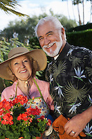 Portrait of senior couple in garden