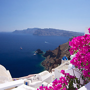 Taking time to smell the flowers while enjoying the amazing views of the Caldera - just another perfect day in Oia!