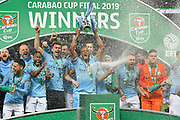 Vincent Kompany (4) of Manchester City lifts the Carabao Cup during the trophy presentations during the Carabao Cup Final match between Chelsea and Manchester City at Wembley Stadium, London, England on 24 February 2019.