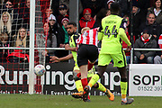 Lincoln City midfielder Elliott Whitehouse (4) shoots at goal  during the EFL Sky Bet League 2 match between Lincoln City and Exeter City at Sincil Bank, Lincoln, United Kingdom on 30 March 2018. Picture by Mick Atkins.