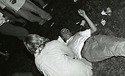 Man lying on grass at the first outdoor rave up North, The Gio Goi Joy Rave run by Anthony and Chris Donnelly, Ashworth Valley, Rochdale, 5th August 1989.