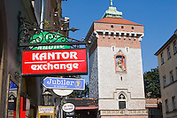 Currency exchange sign and St Florian's Gate Poish Gothic Tower in Krakow Poland