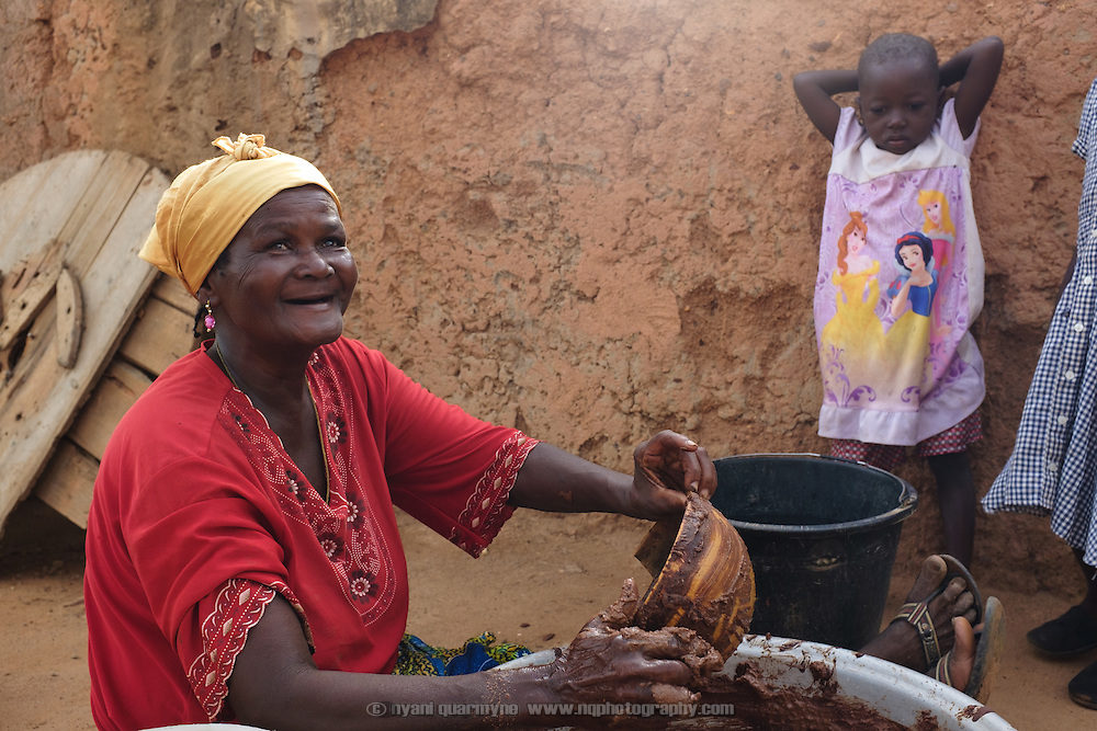 A woman making shea butter in the village of Lyssah in the Upper West region of Ghana. Though incredibly labour-intensive, shea butter production provides an important income stream for many women in the Upper West. The resulting butter is used for cooking as well as skincare.