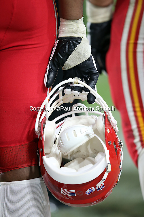 A Kansas City Chiefs player holds his helmet on the sideline during the 2015 NFL preseason football game against the Arizona Cardinals on Saturday, Aug. 15, 2015 in Glendale, Ariz. The Chiefs won the game 34-19. (©Paul Anthony Spinelli)