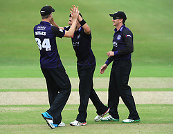 Benny Howell of Gloucestershire celebrates with Craig Miles of Gloucestershire after Adam Wheater of Hampshire is out for LBW   - Photo mandatory by-line: Dougie Allward/JMP - Mobile: 07966 386802 - 14/07/2015 - SPORT - Cricket - Cheltenham - Cheltenham College - Natwest T20 Blast