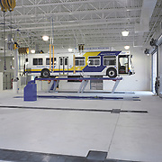 Chula Vista city bus on lift in repair facility.