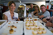A waitress smiles at Jean Restaurant in Biarritz, France. Biarritz is a city which lies on the Bay of Biscay, on the Atlantic coast, in south-western France. It is a luxurious seaside town and is popular with tourists and surfers. Photographer: Markel Rendondo/Fedephoto.
