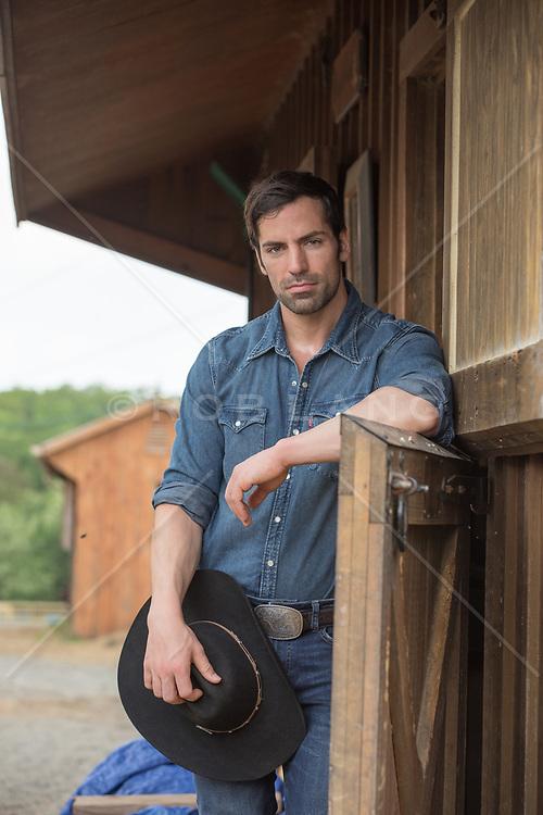 rugged hot cowboy on a ranch