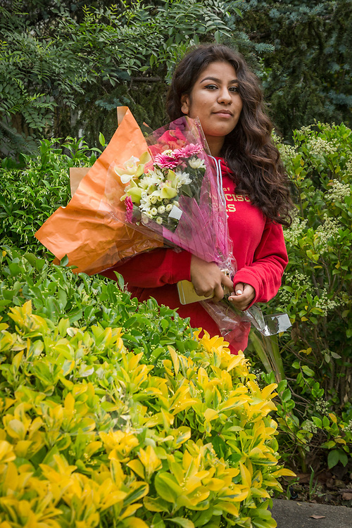 "Tenth grade Calistoga High School student Karina Hernandez returns from Calmart with Flowers for Mother's Day.  ""Today is Mother's Day in Mexico."""