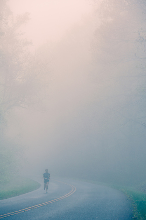 Woman ringing in fog on Blue Ridge Parkway.