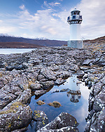 The lighthouse at Rhue, north of Ullapool in northwest Scotland, looks ghostly as it blends with the background. Set at the head of Loch Broom it enables seafarers to navigate into port. It is unmanned, and not actually that large, maybe 25 feet tall. The setting is spectacular though.