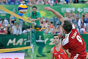 Cezary Pazura attacks while exhibition match of Special Olympics Poland during Day 7 of the FIVB World Championships on July 7, 2013 in Stare Jablonki, Poland. <br /> <br /> Poland, Stare Jablonki, July 07, 2013<br /> <br /> Picture also available in RAW (NEF) or TIFF format on special request.<br /> <br /> For editorial use only. Any commercial or promotional use requires permission.<br /> <br /> Mandatory credit:<br /> Photo by &copy; Adam Nurkiewicz / Mediasport