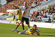Bradford City midfielder Nicky Law (4) commits a foul on Oxford United defender Phil Edwards (16) during the EFL Sky Bet League 1 match between Oxford United and Bradford City at the Kassam Stadium, Oxford, England on 15 October 2016. Photo by Alan Franklin.