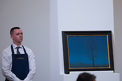 "© Licensed to London News Pictures. 21/06/2017. London, UK. ""La Recherche de L'Absolu"", 1940, by René Magritte sold for a hammer price of GBP1.6m (estimate GBP1-1.5m) at Sotheby's Impressionist and Modern Art evening sale in New Bond Street. Photo credit : Stephen Chung/LNP"
