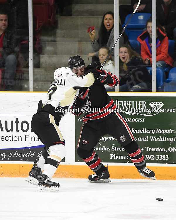 TRENTON, ON - APR 15,  2017: Ontario Junior Hockey League, Championship Series. Georgetown Raiders vs the Trenton Golden Hawks in Game 2 of the Buckland Cup Final.  Brandon Marinelli #7 of the Trenton Golden Hawks battles for control with Josh Dickinson #28 of the Georgetown Raiders during the first period.<br /> (Photo by Andy Corneau / OJHL Images)