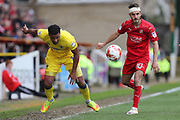 AFC Wimbledon midfielder Tom Soares (14) and Swindon Town midfielder John Goddard (10) during the EFL Sky Bet League 1 match between Swindon Town and AFC Wimbledon at the County Ground, Swindon, England on 14 April 2017. Photo by Stuart Butcher.
