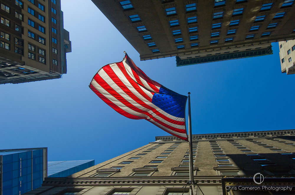 United States of America flag flying from the side of a building in Manhattan, New York City.