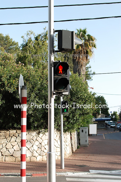 Pedestrian Traffic light red stop light in the foreground and green go or walk light in the background Photographed in Israel