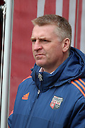 Brentford Head Coach Dean Smith looking on during the Sky Bet Championship match between Brentford and Bristol City at Griffin Park, London, England on 16 April 2016. Photo by Matthew Redman.
