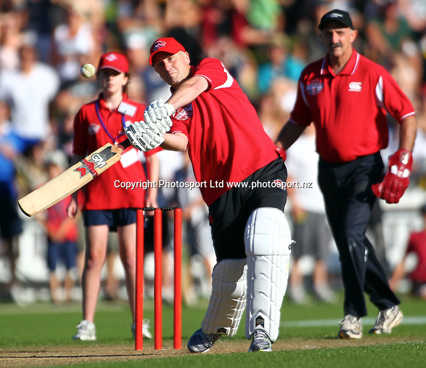 """Prime Minister John Key faces a ball from Shane Warne during the"""" Fill the Basin for Christchurch"""", Charity match - Wellington v Canterbury at the Allied Nationwide Finance Basin Reserve, Wellington, New Zealand on Sunday, 13 March 2011. Photo: Justin Arthur/ photosport.co.nz"""