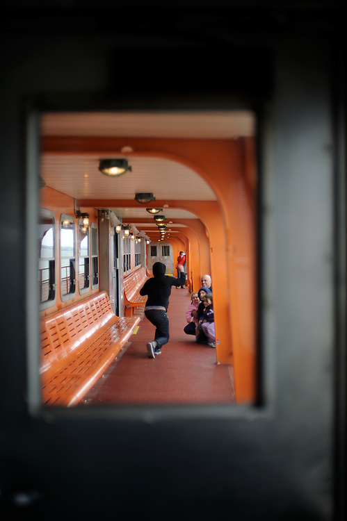 Family poses for some portraits on Staten Island Ferry en route to New York City.
