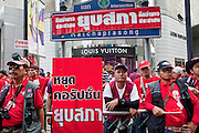 "Apr 4, 2010 - BANGKOK, THAILAND: Red Shirt protestors block the entrance to the Louis Vuitton high end luggage store in Bangkok Apr. 4. Thousands of members of the United Front of Democracy Against Dictatorship (UDD), also known as the ""Red Shirts"" and their supporters moved their anti government protests into central Bangkok Apr. 4 when they occupied Ratchaprasong intersection, the site of Bangkok's fanciest shopping malls and several 5 star hotels. The Red Shirts are demanding the resignation of current Thai Prime Minister Abhisit Vejjajiva and his government. The protest is a continuation of protests the Red Shirts have been holding across Thailand. They support former Prime Minister Thaksin Shinawatra, who was deposed in a coup in 2006 and went into exile rather than go to prison after being convicted on corruption charges. Thaksin is still enormously popular in rural Thailand. This move, away from their traditional protest site in the old part of Bangkok, has gridlocked the center of the city and closed hundreds of stores and restaurants and several religious shrines. There has not been any violence, but the government had demanded that the Red Shirts return to the old part of the city.   PHOTO BY JACK KURTZ"